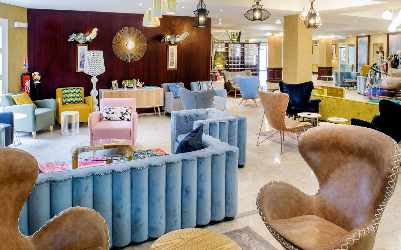 Comfortable and design lounge with colorful armchairs near the reception, hotel restaurant pyrenees, Hotel La Solitude.