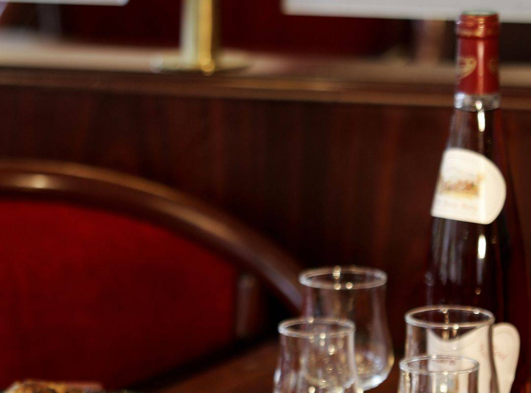 Delicious paella served with red wine, brasserie lourdes, Hotel La Solitude.